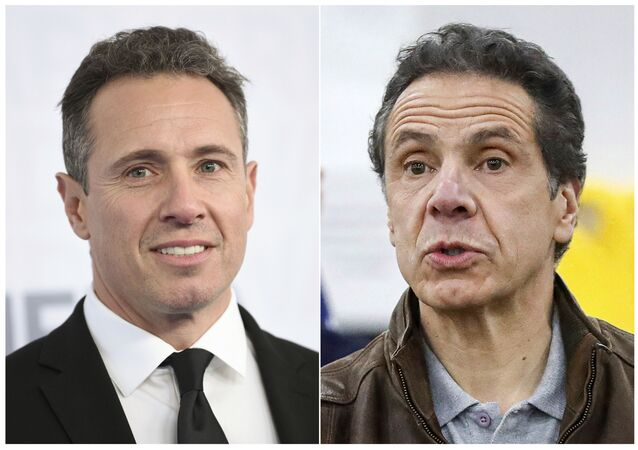 This combination photo shows CNN news anchor Chris Cuomo at the WarnerMedia Upfront in New York on May 15, 2019, left, and New York Gov. Andrew Cuomo speaking during a news conference in New York on March 23, 2020