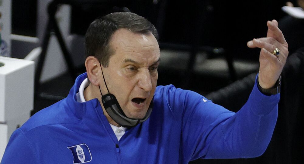 Head coach Mike Krzyzewski of the Duke Blue Devils reacts following a play during the first half of their second round game against the Louisville Cardinals in the ACC Men's Basketball Tournament at Greensboro Coliseum on March 10, 2021 in Greensboro, North Carolina.