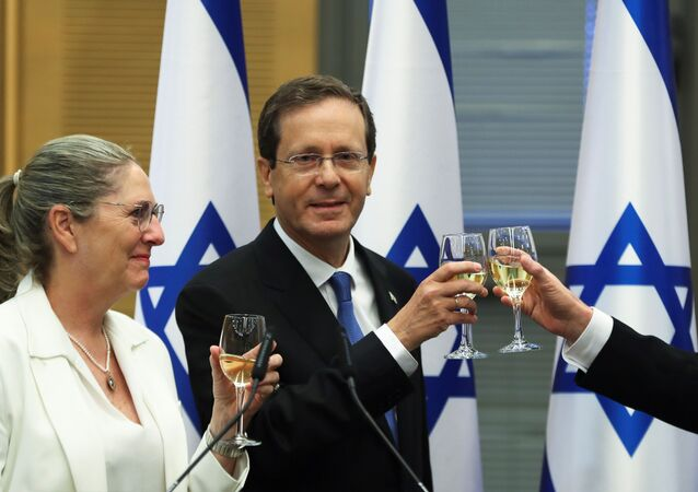President-elect Isaac Herzog and his wife Michal celebrate after a special session of the Knesset whereby Israeli lawmakers elected the new president, at the Knesset, Israel's parliament, in Jerusalem June 2, 2021.