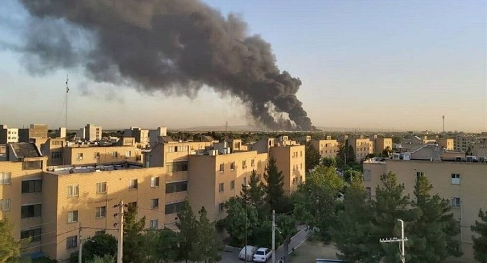 Smoke rises at an oil refinery in Tehran, Iran June 2, 2021
