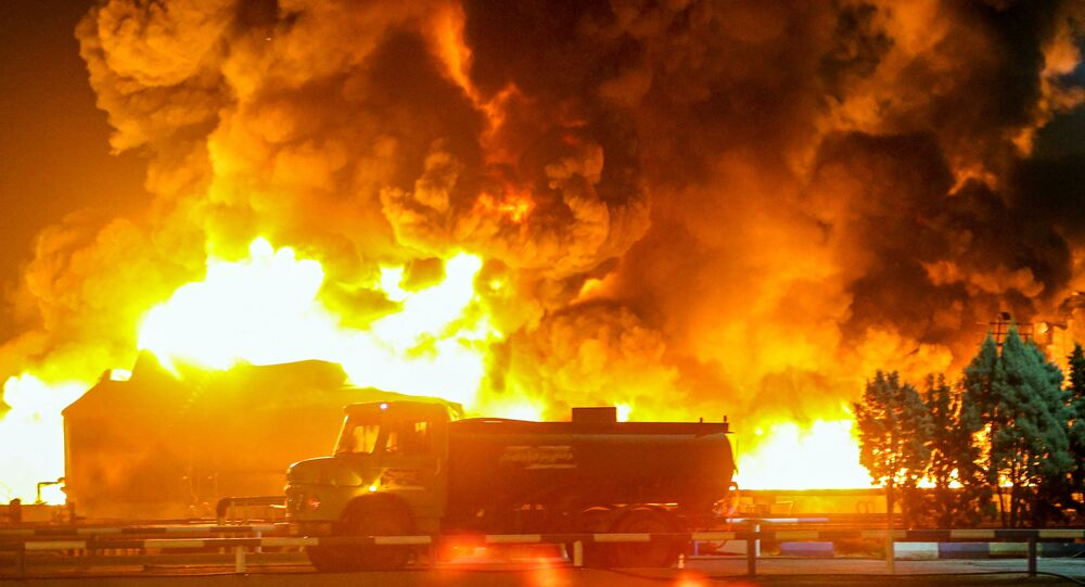 A picture taken late on June 2, 2021, shows fire raging at an oil refinery in the Iranian capital Tehran. - A fierce blaze broke out at the refinery in southern Tehran after a liquefied gas line leaked and exploded, the head of the capital's crisis team said on state television.