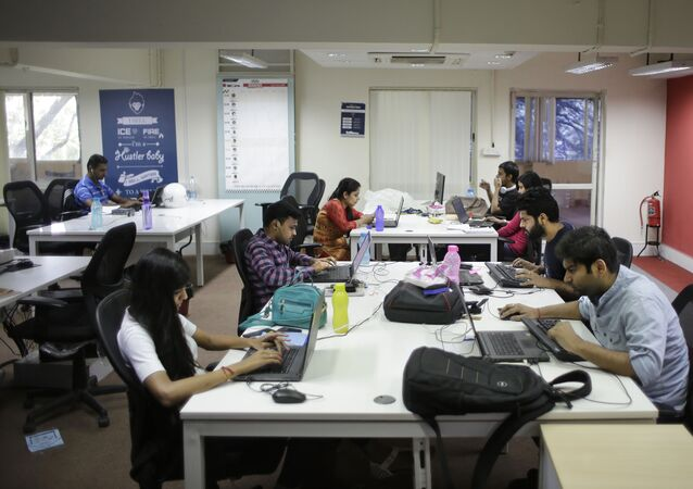 Employees work on their computers at the office of HackerEarth in Bangalore, India, Wednesday, Oct. 14, 2015