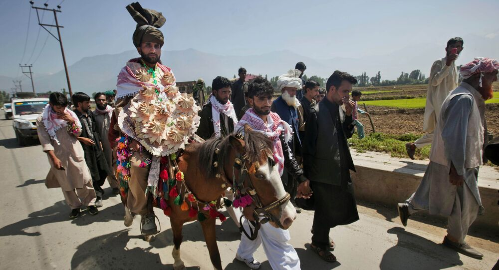 Mohammad Farooq, a Kashmiri Bakarwal nomad arrives for his wedding ceremony  on a horse on the outskirts of Srinagar, India, Friday, May 31, 2013
