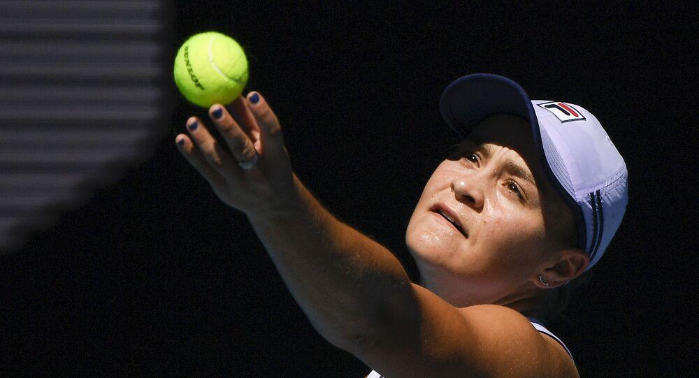 Australia's Ash Barty serves to Karolina Muchova of the Czech Republic during their quarterfinal match at the Australian Open tennis championship in Melbourne, Australia