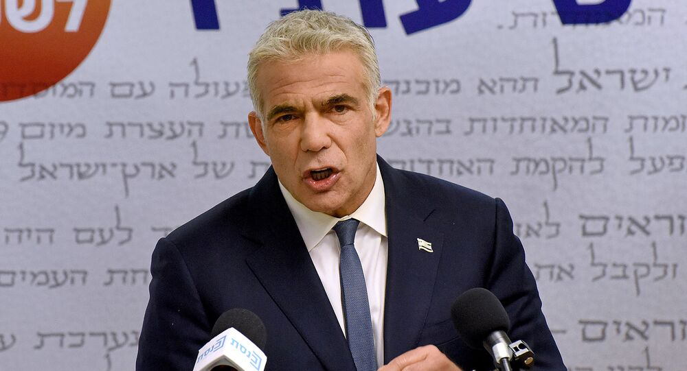 Israel's centrist opposition leader Yair Lapid delivers a statement to the press at the Knesset (Israeli parliament) in Jerusalem on May 31, 2021. - Lapid said many obstacles remain before a diverse coalition to oust long-serving right-wing Prime Minister Benjamin Netanyahu can be agreed.