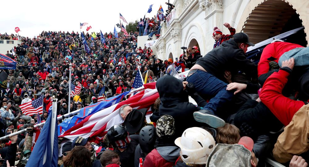 Pro-Trump protesters storm into the U.S. Capitol during clashes with police, during a rally to contest the certification of the 2020 U.S. presidential election results by the U.S. Congress, in Washington, U.S, January 6, 2021