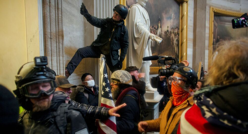 FILE PHOTO: Pro-Trump protesters storm the U.S. Capitol to contest the certification of the 2020 U.S. presidential election results by the U.S. Congress, at the U.S. Capitol Building in Washington, DC., 6 January 2021.