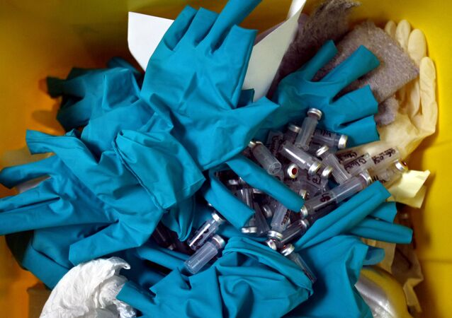A picture taken at the French national anti-doping laboratory, on 23 June 2008 in Chatenay-Malabry, outside Paris, shows a waste bin filled with gloves, syringes and test tubes used for blood samples.