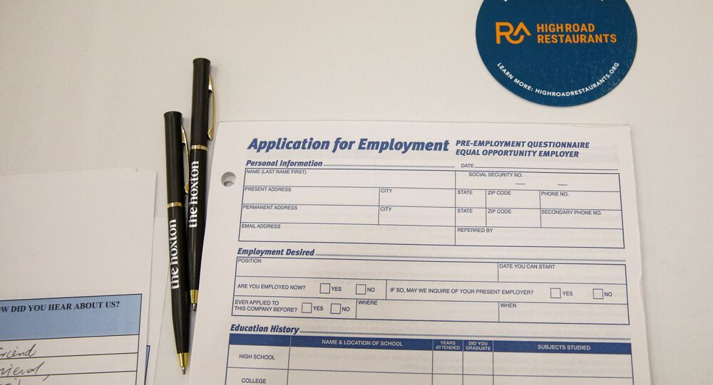 An employment application form is displayed during a restaurant job career fair organized by the industry group High Road Restaurants in New York City, U.S., May 13, 2021.