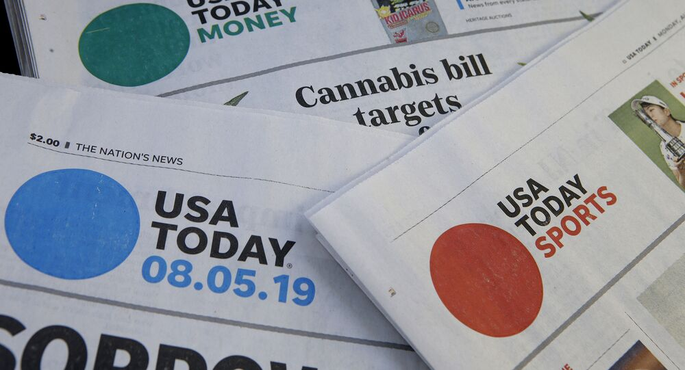 FILE - In this Aug. 5, 2019, file photo, sections of a USA Today newspaper rest together in Norwood, Mass. Gannett Co., Inc. reports earnings Thursday, Feb. 27.