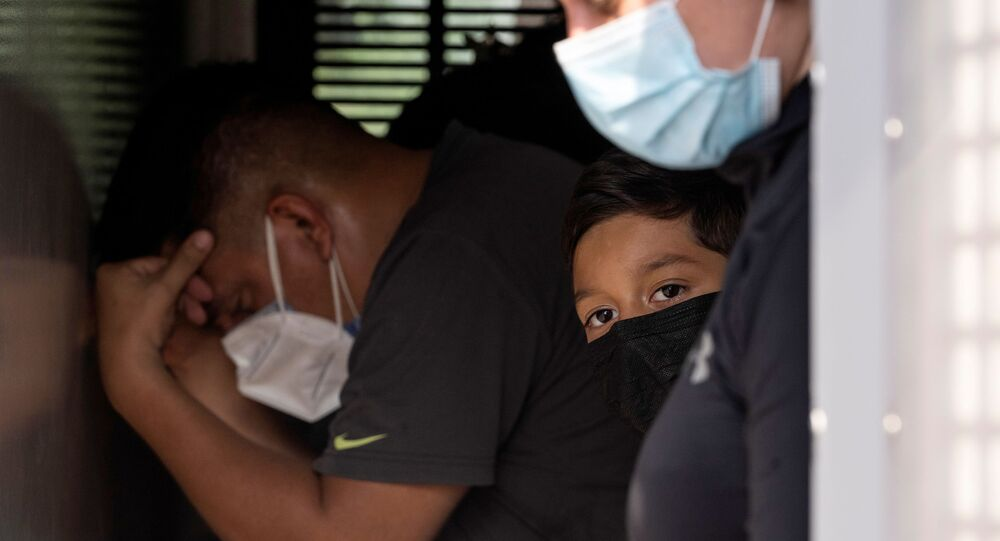 Asylum-seeking migrants' families from Venezuela wait to be transported by the U.S. Border Patrol   van after crossing the Rio Grande river into the United States from Mexico in Del Rio, Texas, U.S., May 26, 2021