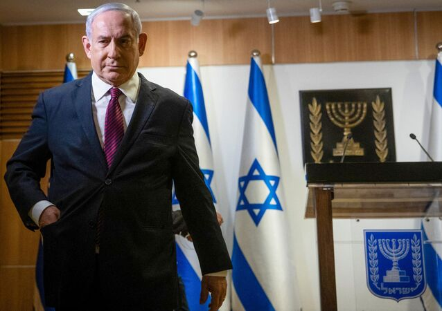 In this file photo taken on December 22, 2020 Israeli Prime Minister Benjamin Netanyahu leaves after a speech at the Knesset (Israeli Parliament) in Jerusalem