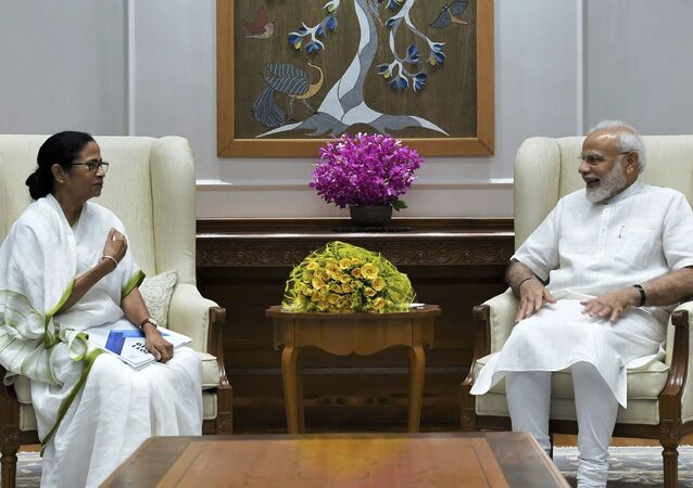 In this handout photo provided by the Press Information Bureau, Indian Prime Minister Narendra Modi meets with Chief Minister of West Bengal state Mamata Banerjee in New Delhi, India, Wednesday, Sept. 18, 2019.