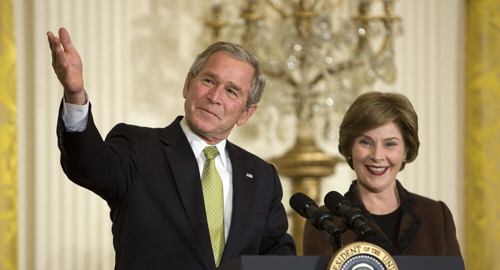 US President George W. Bush (L) and First Lady Laura Bush speak during a National Adoption Day event in the East Room of the White House in Washington, DC, 16 November 2007.