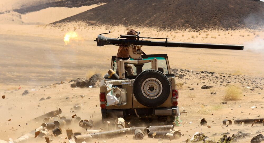 A Yemeni government fighter fires a vehicle-mounted weapon at a frontline position during fighting against Houthi fighters in Marib, Yemen March 9, 2021