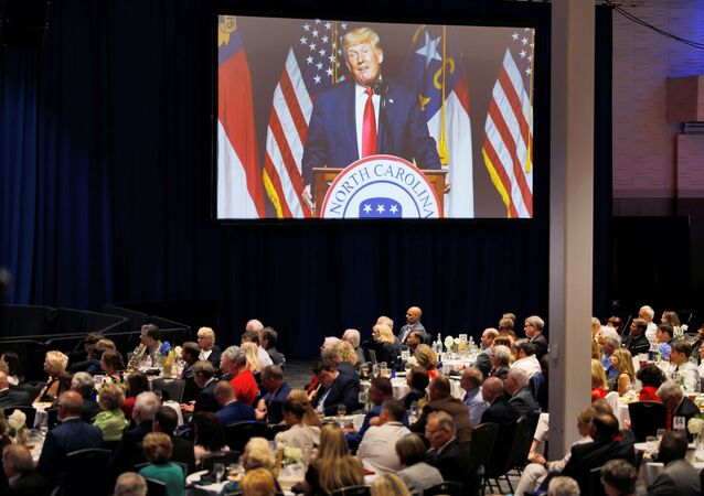 Former U.S. President Donald Trump appears on a giant live video screen as he speaks at the North Carolina GOP convention dinner in Greenville, North Carolina, U.S. June 5, 2021