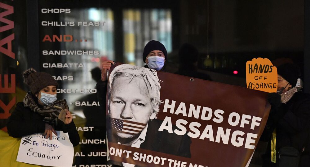 Protesters hold a sign to support WikiLeaks founder Julian Assange in front of the EU British Embassy in Brussels on December 07, 2020