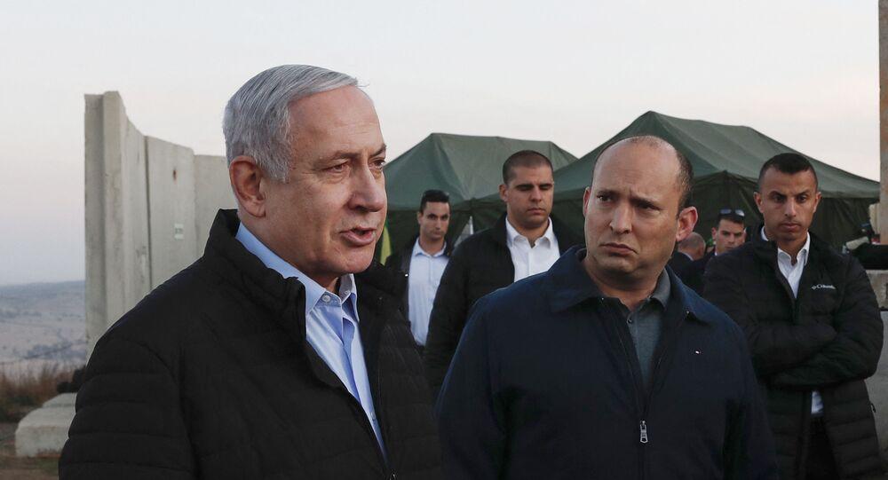 Israel's Prime Minister Benjamin Netanyahu (L) and Defence Minister Naftali Bennett (2nd) visit an army base in the Israeli-annexed Golan Heights overlooking Syrian territory, on November 24, 2019.