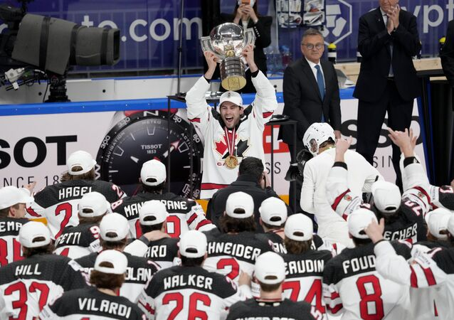 Canada players celebrate with the trophy after winning the IIHF World Ice Hockey Championship 2021, June 6, 2021
