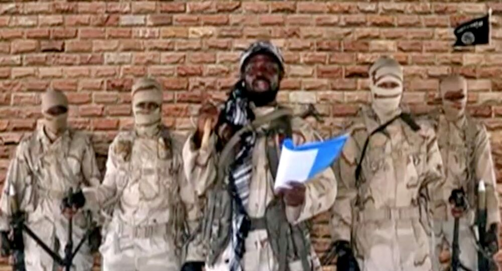 Boko Haram leader Abubakar Shekau speaks in front of guards in an unknown location in Nigeria in this still image taken from an undated video obtained on January 15, 2018.