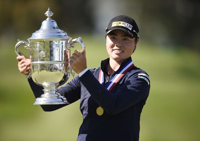 Yuka Saso hoists the US Open trophy after winning in a sudden death playoff over Nasa Hataoka following the final round of the U.S. Women's Open golf tournament at The Olympic Club, Jun 6, 2021
