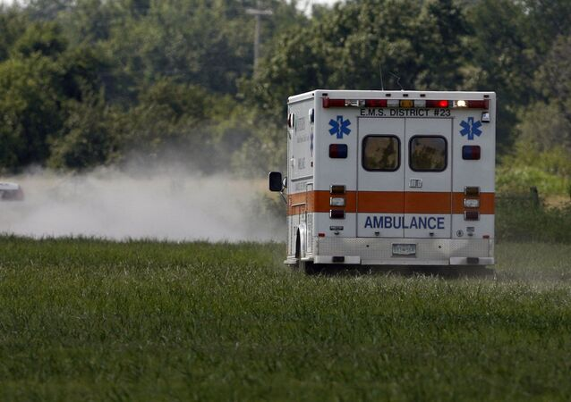 MIAMI, OK - JULY 23:  The ambulance carries thirty eight year old Trigger Gumm, who crashed while attempting a 315-foot motorcycle jump on a 450cc Service Honda outfitted with a custom-built 4-stroke engine at Buffalo Run Casino, July 23, 2006 in Miami, Oklahoma. If not for the crash, the jump would have been a world record with the length of more than a football field. After the crash, Gumm was able to walk to the medical car that transported him to a hospital for further evaluation.
