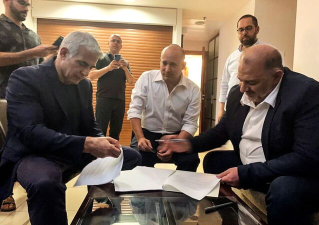 United Arab List party leader Mansour Abbas, Yamina party leader Naftali Bennett and Yesh Atid party leader Yair Lapid, sit together in Ramat Gan, near Tel Aviv, Israel June 2, 2021. Picture taken June 2, 2021