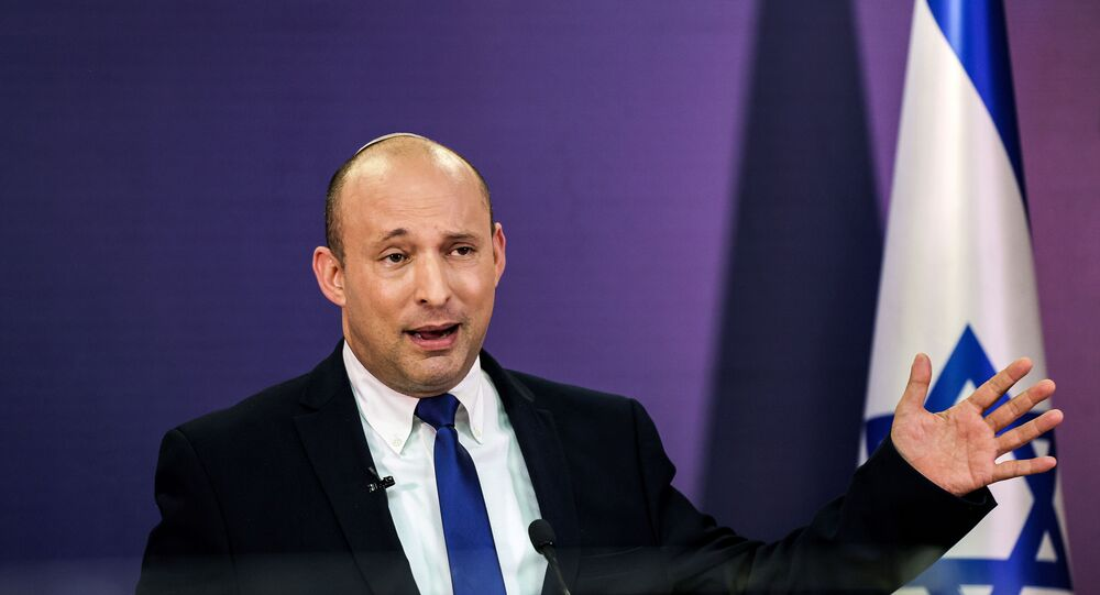 Naftali Bennett, Israeli parliament member from the Yamina party, gestures as he gives a statement at the Knesset, Israel's parliament, in Jerusalem, June 6, 2021