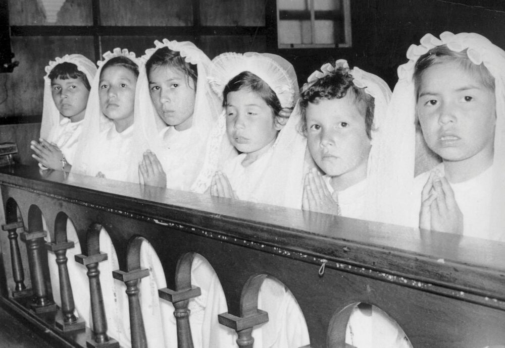Girls attend a first communion ceremony at the Spanish Indian Residential School in Spanish, Ontario, Canada in 1955.