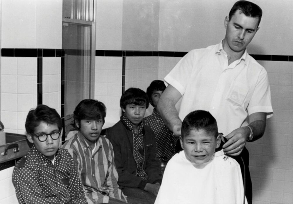 Boys receive haircuts at the Shingwauk Indian Residential School in Sault Ste. Marie, Ontario, Canada circa 1960s.