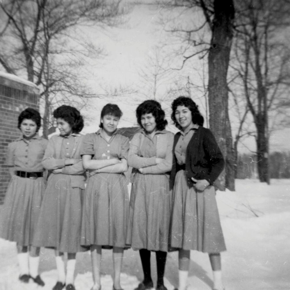 Senior girl students pose outside the Shingwauk Indian Residential School in Sault Ste. Marie, Ontario, Canada circa 1960s.