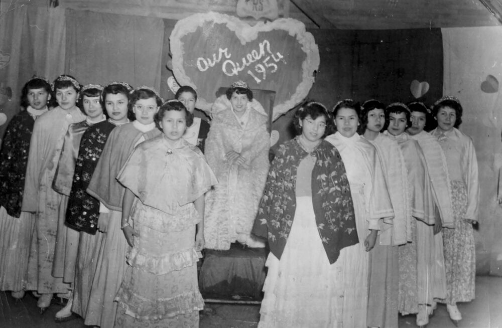 Girls pose during a pageant at the Spanish Indian Residential School in Spanish, Ontario, Canada in 1954.