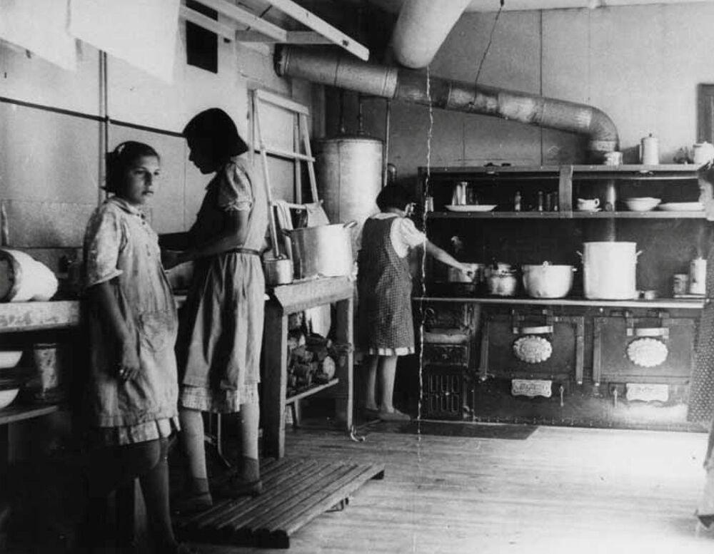 Girls work in the kitchen at the Bishop Horden Memorial School circa 1940.