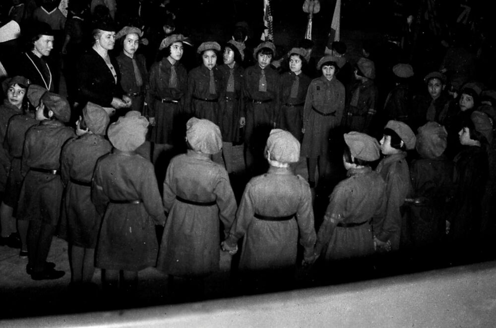 Shinwauk Guides form a circle during the visit of the commissioner to the Shingwauk Indian Residential School in Sault Ste. Marie, Ontario, Canada circa 1951.