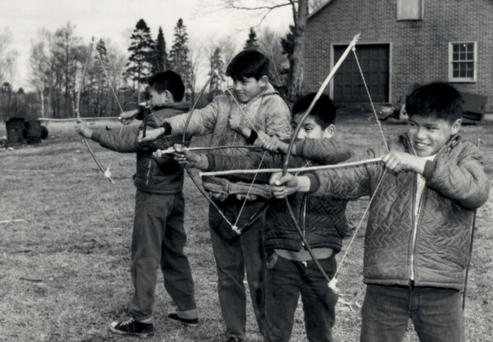 Students attending the Shingwauk Indian Residential School use handmade bows in Sault Ste. Marie, Ontario, Canada in 1960.