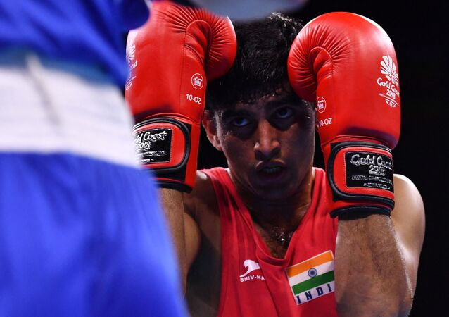 India's Manish Kaushik (R) guards against Northern Ireland's James McGivern during their men's 60kg semi-final boxing match during the 2018 Gold Coast Commonwealth Games at the Oxenford Studios venue on the Gold Coast on April 13, 2018
