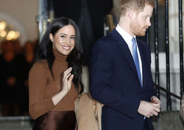 In this 7 January 2020 file photo, Britain's Prince Harry and Meghan, Duchess of Sussex, leave after visiting Canada House in London.