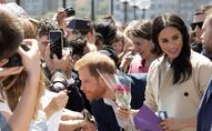 Britain's Prince Harry and Meghan, Duchess of Sussex meet members of the public during a walk about outside the Sydney Opera House in Australia on Tuesday, 16 October 2018.