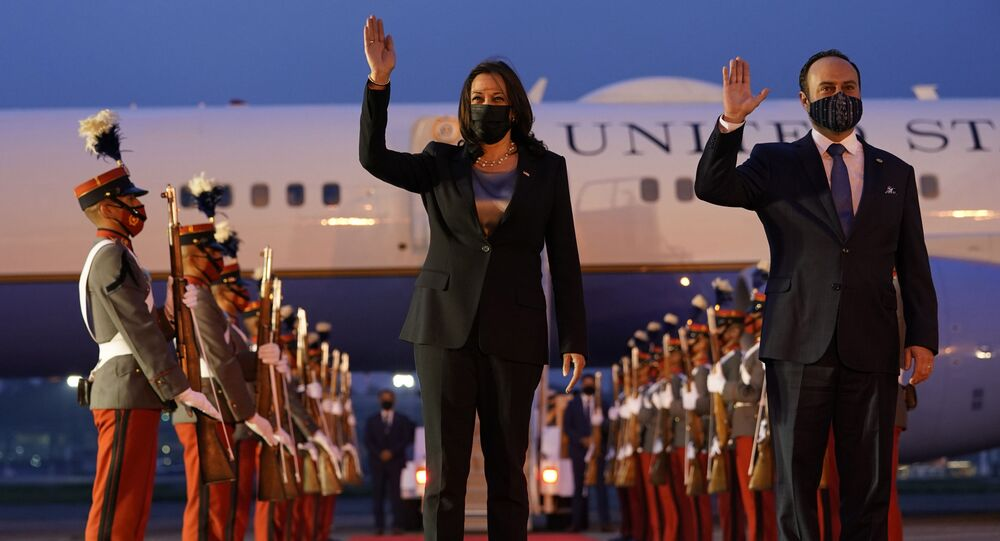 Vice President Kamala Harris and Guatemala's Minister of Foreign Affairs Pedro Brolo wave at her arrival ceremony in Guatemala City, Sunday, June 6, 2021, at Guatemalan Air Force Central Command