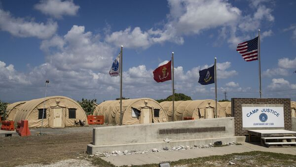 In this April 18, 2019, file photo, in this photo reviewed by U.S. military officials, flags fly in front of the tents of Camp Justice in Guantanamo Bay Naval Base, Cuba. - Sputnik International