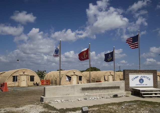In this April 18, 2019, file photo, in this photo reviewed by U.S. military officials, flags fly in front of the tents of Camp Justice in Guantanamo Bay Naval Base, Cuba.