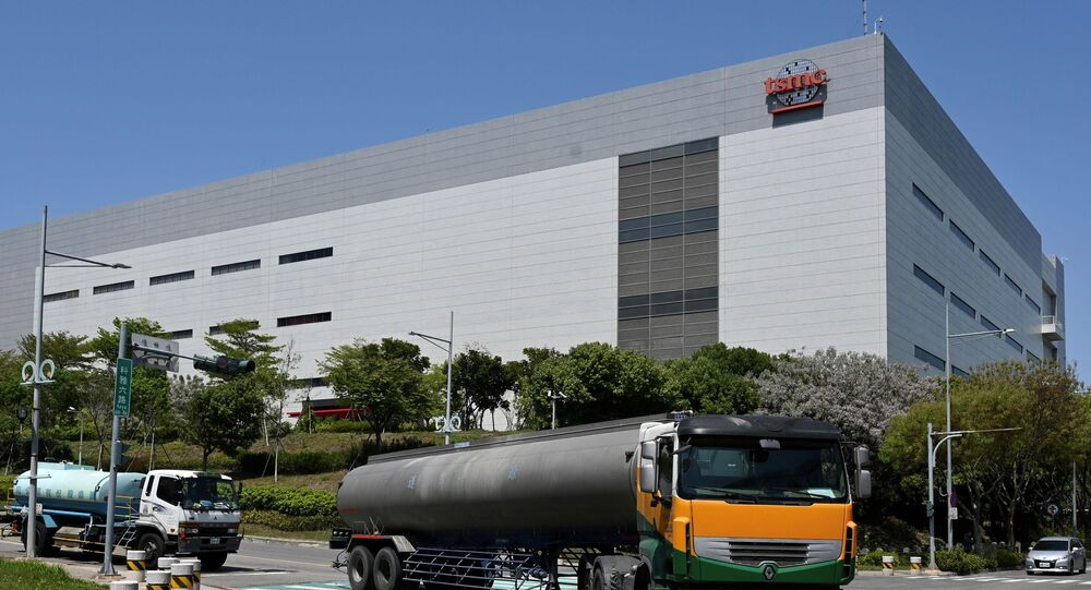 This photo taken on March 25, 2021 shows two water trucks passing a Taiwan Semiconductor Manufacturing Company (TSMC) factory in Taichung, central Taiwan.