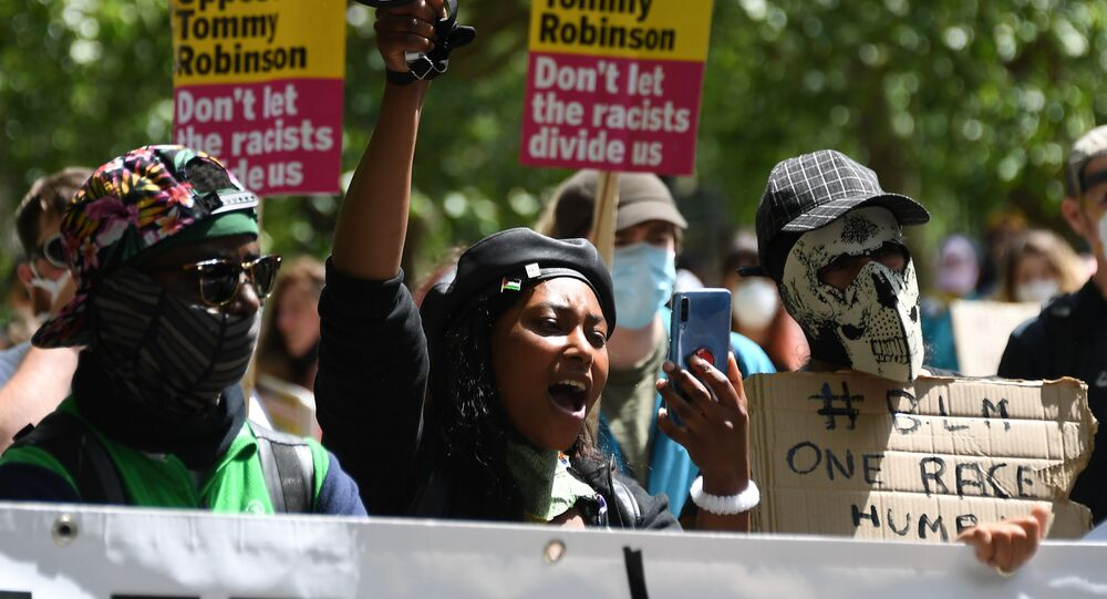 In this Saturday, June 13, 2020 file photo Sasha Johnson, center, of the Black Lives Matter movement attends a protest at Hyde Park in London