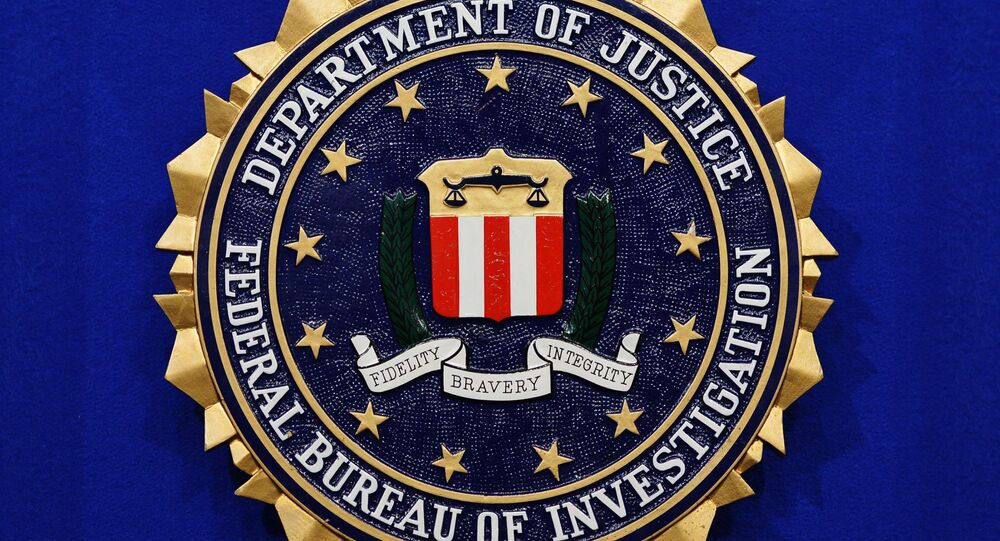 The Federal Bureau of Investigation (FBI) seal is seen on the lectern following a press conference announcing the FBI's 499th and 500th additions to the Ten Most Wanted Fugitives list on June 17, 2013 at the Newseum in Washington, DC.