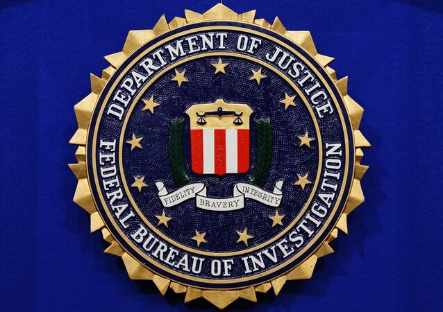 The Federal Bureau of Investigation (FBI) seal is seen on the lectern following a press conference announcing the FBI's 499th and 500th additions to the Ten Most Wanted Fugitives list on 17 June 2013 at the Newseum in Washington, DC.