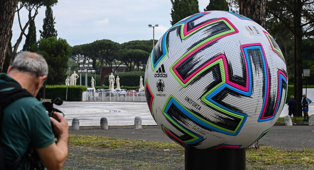 A video journalist films a giant football of the Euro 2020 European football tournament on 8 June 2021 by the Olympic stadium in Rome, three days before the delayed competition finally kicks off on June 11 in Rome when Italy hosts Turkey.