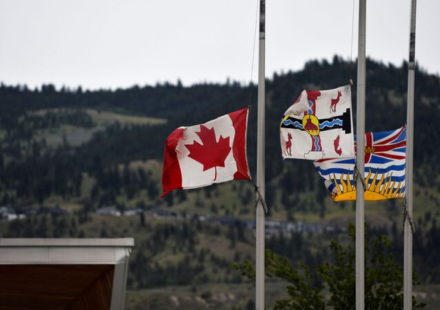 The Canadian flag flies at half-mast near the grounds of the former Kamloops Indian Residential School.