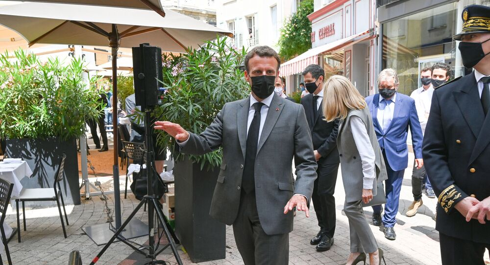 French President Emmanuel Macron arrives for a lunch in Valence, on June 8, 2021, during a day visit in the French southeastern department of Drome, the second stage of a nationwide tour ahead of next year's presidential election. - A bystander slapped Emmanuel Macron across the face during a trip to southeast France on June 8 on the second stop of a nation-wide tour.