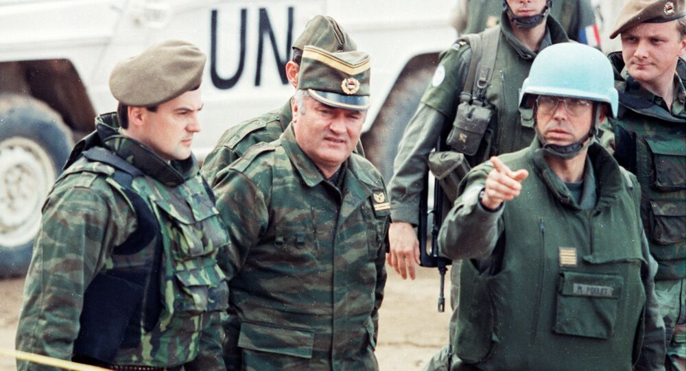 Bosnian Serb General Ratko Mladic is guided by a French Foreign Legion officer as he arrives at a meeting hosted by French U.N. commander General Philippe Morillon at the airport in Sarajevo, Bosnia and Herzegovina in March, 1993.