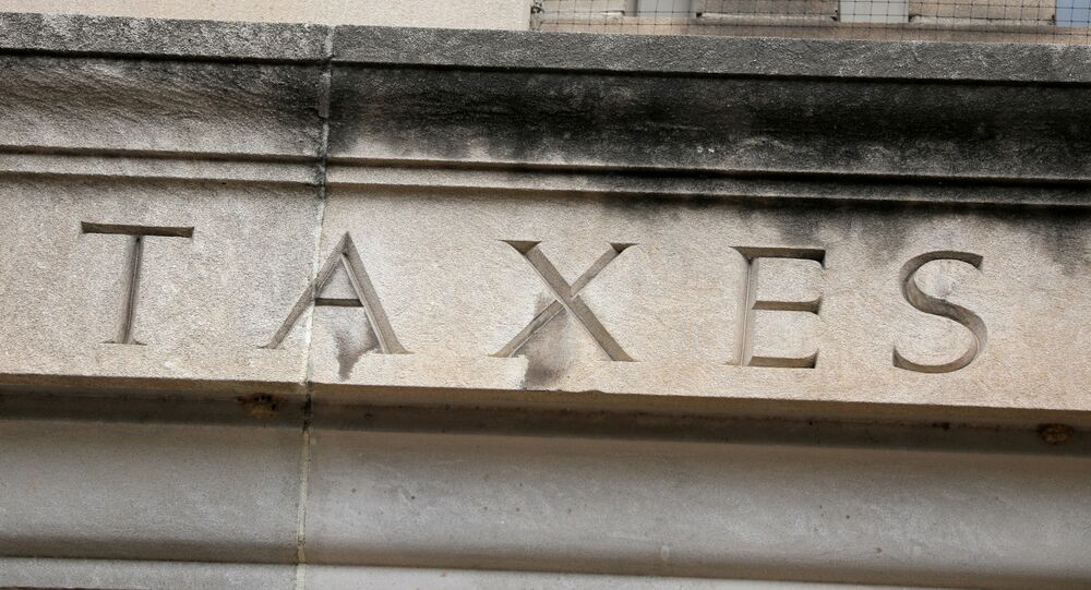 The word taxes is seen engraved at the headquarters of the Internal Revenue Service (IRS) in Washington, D.C., U.S., May 10, 2021.